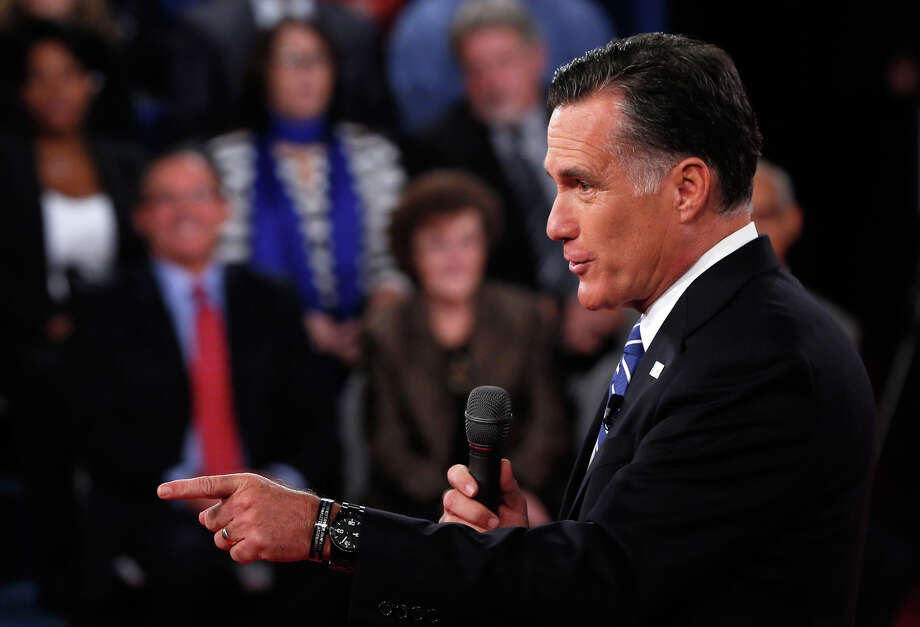 HEMPSTEAD, NY - OCTOBER 16:  Republican presidential candidate Mitt Romney answers a question during a town hall style debate at Hofstra University October 16, 2012 in Hempstead, New York. During the second of three presidential debates, the candidates fielded questions from audience members on a wide variety of issues. (Photo by Shannon Stapleton-Pool/Getty Images) Photo: Pool, Getty Images / 2012 Getty Images
