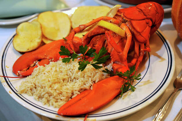 A lobster dinner is featured on The Atlantic Restaurant's menu. Photographed at the restaurant in Danbury on Tuesday, Oct. 16, 2012. Photo: Jason Rearick / The News-Times