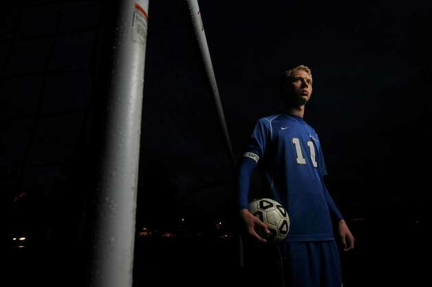 Albany High School soccer player Tyler Stempsey stands near the goal after their game with La Salle Institute was rained out, on Monday Oct. 15, 2012 in Troy, NY.  (Philip Kamrass /  Times Union) Photo: Philip Kamrass / 00019648A