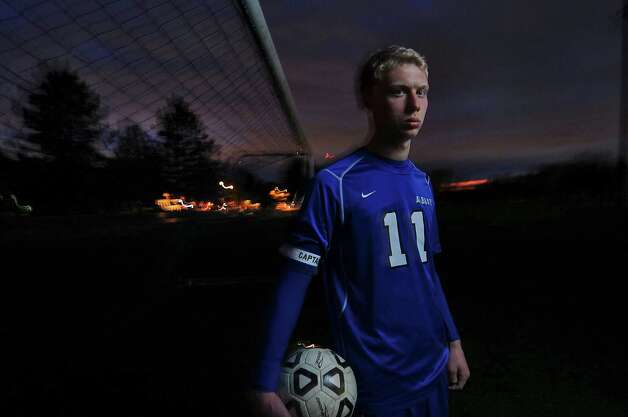 Albany High School soccer player Tyler Stempsey stands near a goal after their game with La Salle Institute was rained out, on Monday Oct. 15, 2012 in Troy, NY.  (Philip Kamrass /  Times Union) Photo: Philip Kamrass / 00019648A
