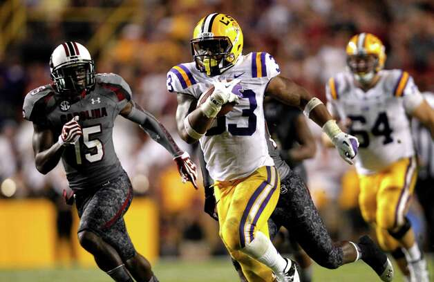 LSU's Jeremy Hill runs for a 50-yard touchdown last week against South Carolina. Photo: Gerald Herbert, Associated Press / AP
