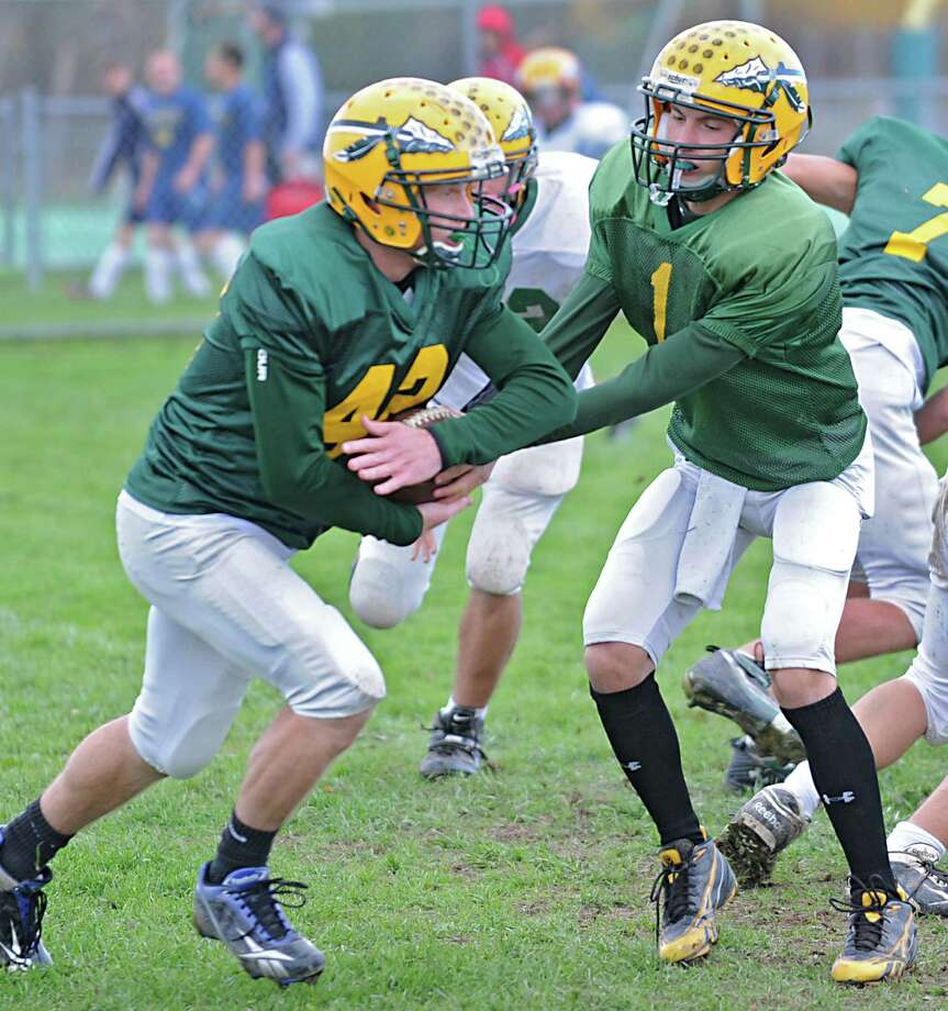 Ravena football player Dylan Keyer, left, receives a hand off from quarterback Connor Zeoli during practice Tuesday, Oct. 16, 2012 in Ravena, N.Y. (Lori Van Buren / Times Union) Photo: Lori Van Buren