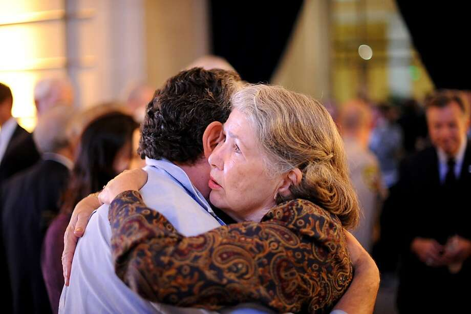 Mary Commanday, mother of slain Ambassador J. Christopher Stevens, hugs a well-wisher at the service in San Francisco. Photo: Noah Berger, Special To The Chronicle