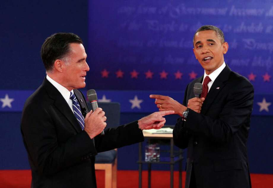 Mitt Romney and President Barack Obama interact at a town hall style presidential debate at Hofstra University in Hempstead, N.Y., Oct. 16, 2012. Photo: RICHARD PERRY, New York Times / NYTNS