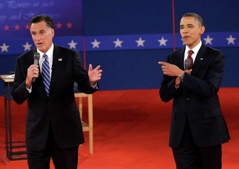 President Barack Obama and Republican presidential nominee Mitt Romney exchange views during the second presidential debate at Hofstra University, Tuesday, Oct. 16, 2012, in Hempstead, N.Y. (AP Photo/Eric Gay) Photo: Eric Gay, STF / AP