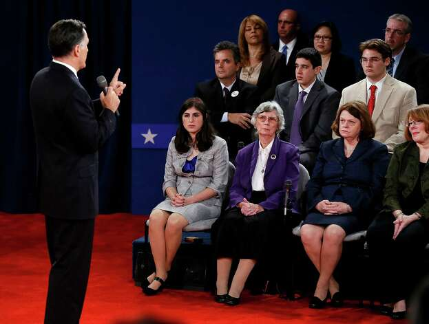 Audience members listen as Republican presidential nominee Mitt Romney answers a question during the second presidential debate at Hofstra University, Tuesday, Oct. 16, 2012, in Hempstead, N.Y. (AP Photo/Pool, Rick Wilking) Photo: Rick Wilking, Pool / Reuters Pool