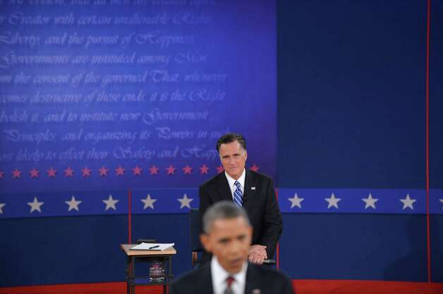US President Barack Obama (front) speaks as Republican Presidential nominee Mitt Romney listens during the second presidential debate October 16, 2012 in Mack Arena at Hofstra University in Hempstead, New  York. AFP PHOTO/Stan HONDASTAN HONDA/AFP/Getty Images Photo: STAN HONDA, Staff / AFP