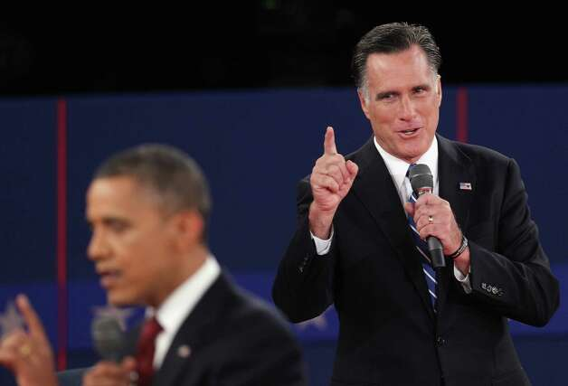 HEMPSTEAD, NY - OCTOBER 16:  Republican presidential candidate Mitt Romney (R) speaks as U.S. President Barack Obama answers a question during a town hall style debate at Hofstra University October 16, 2012 in Hempstead, New York. During the second of three presidential debates, the candidates fielded questions from audience members on a wide variety of issues.  (Photo by John Moore/Getty Images) Photo: John Moore, Staff / 2012 Getty Images