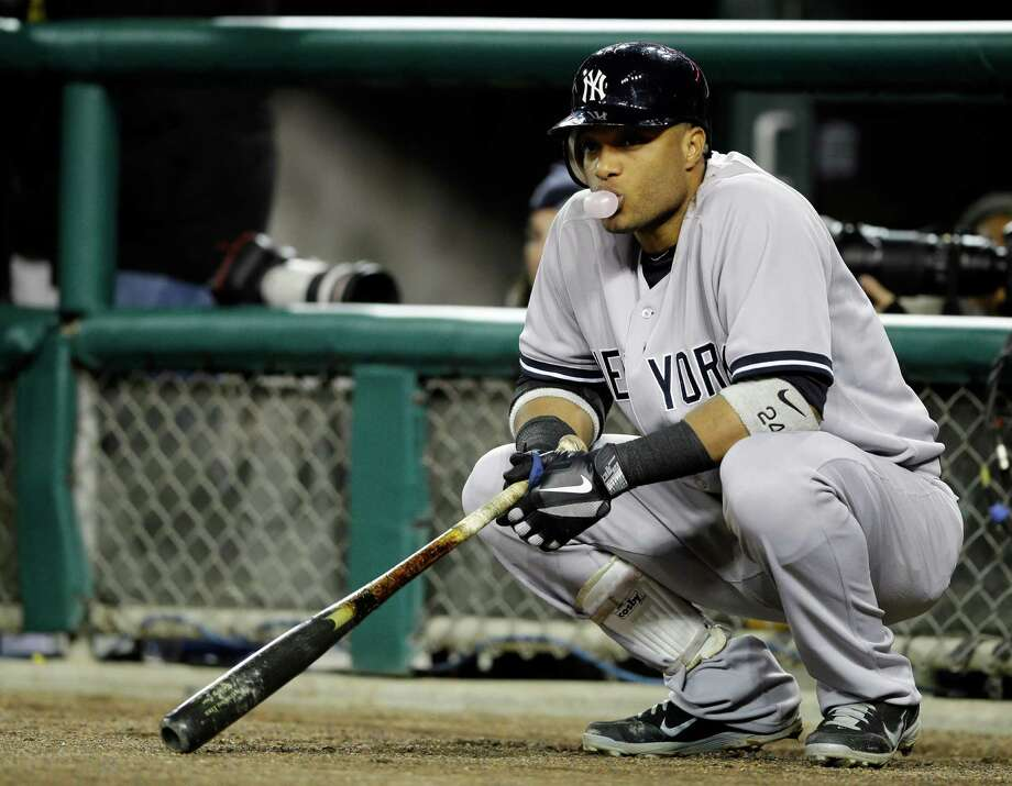 New York Yankees' Robinson Cano blows a bubble as he waits to hit in the fourth inning during Game 3 of the American League championship series against the Detroit Tigers Tuesday, Oct. 16, 2012, in Detroit. (AP Photo/Matt Slocum) Photo: Matt Slocum