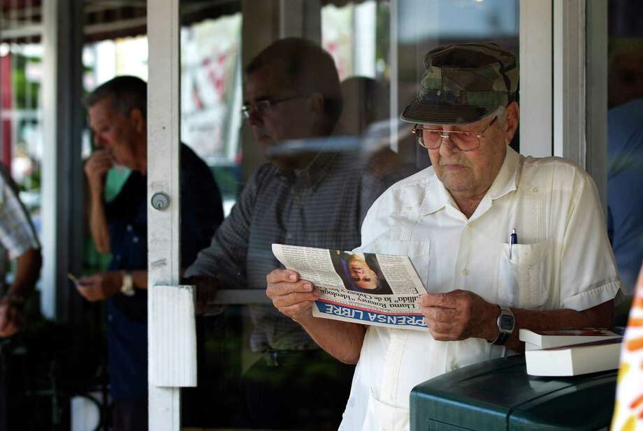 Nino Diaz Reads A Spanish Language Newspaper At A Cuban Cafe In Miamiu0027s  Little Havana Section