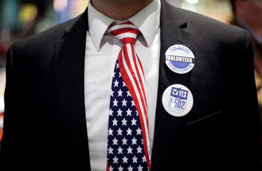 A participant shows his patriotic tie during 'The Next 50' One Stop Ballot Shop debate watch and candidate mingle on Tuesday, October 16, 2012 at the Seattle Center. People gathered in the Center House to watch the debate on a large screen and mingled with candidates and initiative representatives. Photo: JOSHUA TRUJILLO / SEATTLEPI.COM