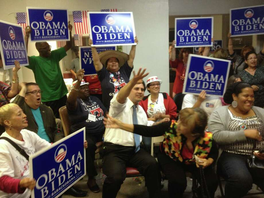 "Bexar County Democratic Party chairman Manuel Medina, center, gestures and shouts ""Four more years!"" at the end of Tuesday's debate between President Barack Obama and GOP nominee Mitt Romney. About 40 activists monitored the debate at the party headquarters. Photo: John W. Gonzalez/Express-News"