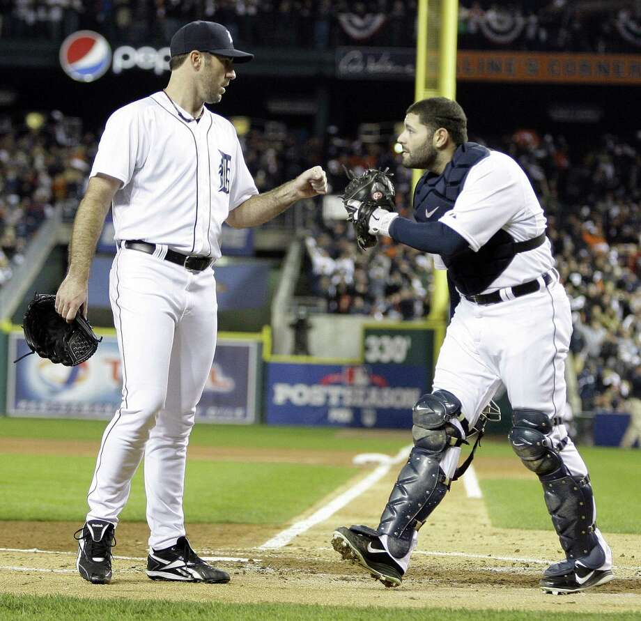 Justin Verlander, left, rewards Alex Avila with a fist pump after the catcher made a catch in foul territory during second-inning action. Photo: JULIAN H. GONZALEZ / Detroit Free Press