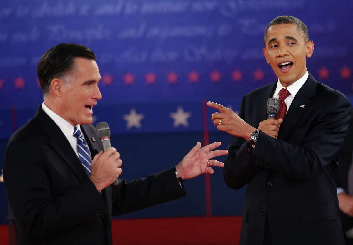 HEMPSTEAD, NY - OCTOBER 16: Republican presidential candidate Mitt Romney (L) and U.S. President Barack Obama talk over each other as they answer questions during a town hall style debate at Hofstra University October 16, 2012 in Hempstead, New York. During the second of three presidential debates, the candidates fielded questions from audience members on a wide variety of issues. (Photo by John Moore/Getty Images)