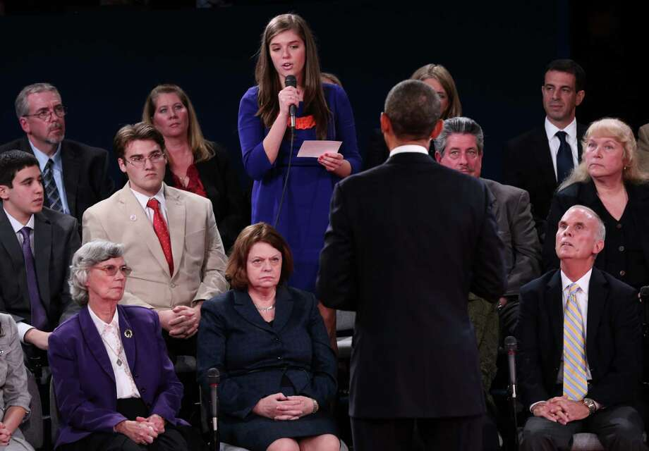 A member of the audience asks President Barack Obama a question during the second presidential debate with Republican presidential nominee Mitt Romney at Hofstra University, Tuesday, Oct. 16, 2012, in Hempstead, N.Y. (AP Photo/Pool-Win McNamee) Photo: Win McNamee