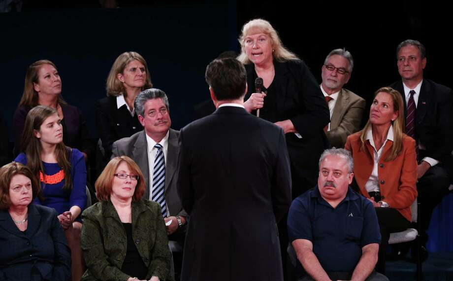 A member of the audience asks Republican presidential nominee Mitt Romney a question during the second presidential debate with President Barack Obama at Hofstra University, Tuesday, Oct. 16, 2012, in Hempstead, N.Y. (AP Photo/Pool-Win McNamee) Photo: Win McNamee