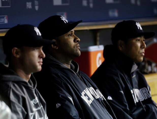 New York Yankees' CC Sabathia, middle, watches during the sixth inning in Game 3 of the American League championship series against the Detroit Tigers Tuesday, Oct. 16, 2012, in Detroit. (AP Photo/Paul Sancya ) Photo: Paul Sancya