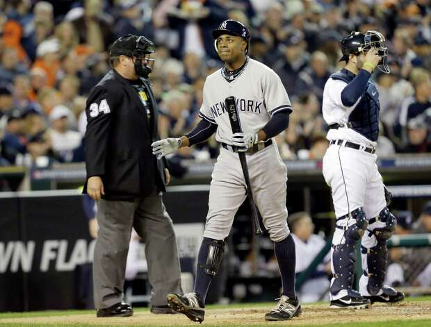 New York Yankees' Curtis Granderson reacts after striking out in the third inning during Game 3 of the American League championship series against the Detroit Tigers Tuesday, Oct. 16, 2012, in Detroit. (AP Photo/Paul Sancya ) Photo: Paul Sancya