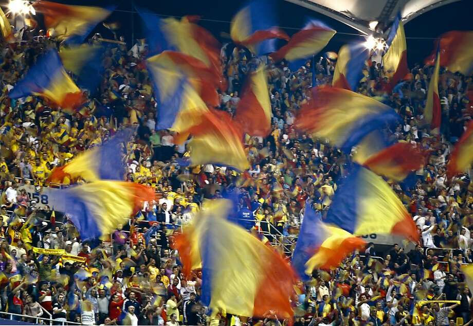 Romania's supporters cheer before their team's World Cup Group D qualifying soccer match against The Netherlands at the National Arena stadium, in Bucharest, Tuesday, Oct. 16, 2012.(AP Photo/Vadim Ghirda) Photo: Vadim Ghirda, Associated Press