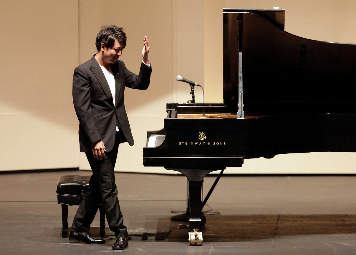 World-renowned pianist Lang Lang acknowledges the applause from a packed house at the Majestic Theater on Tuesday, Oct. 16, 2012.