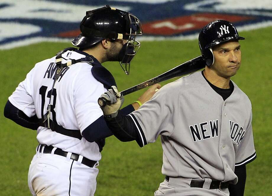 New York Yankees' Raul Ibanez reacts after striking out ending the game as Detroit Tigers' Alex Avila leaves home plate at Game 3 of the American League championship series Tuesday, Oct. 16, 2012, in Detroit. (AP Photo/Carlos Osorio) Photo: Carlos Osorio, Associated Press
