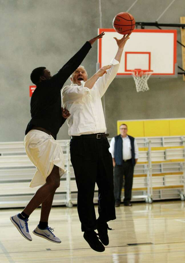 Seattle Mayor Mike McGinn, right, plays one-on-one basketball with A.J. Brooks, assistant athletic director of the Rainier Vista Boys and Girls Club, Tuesday, Oct. 16, 2012, in Seattle, following a ceremony where he signed legislation on the funding plan for construction of a sports arena that could be used to lure the NBA back to Seattle. Photo: Ted S. Warren / Associated Press