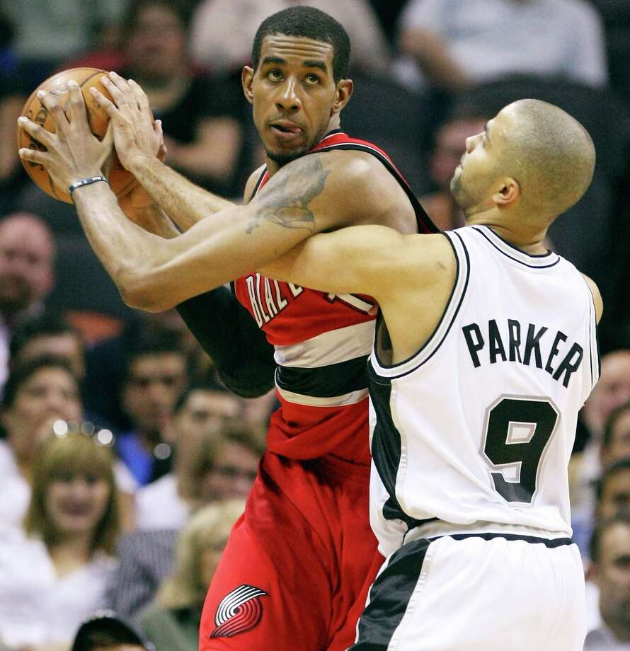 LaMarcus Aldridge: NBA All-Star plays power forward and center for the Portland Trail Blazers. Seen here against the Spurs' Tony Parker in 2009. Photo: Edward A. Ornelas, San Antonio Express-News / eaornelas@express-news.net