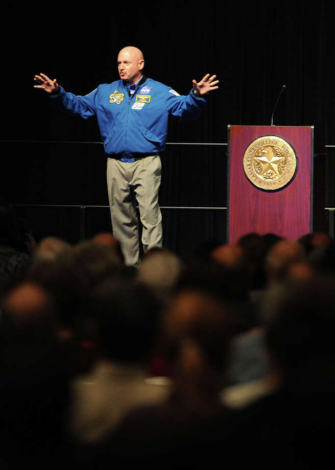 Talking on the tragic shooting of his wife, time in the U.S. Navy and space flight experiences, Mark Kelly speaks to guests at Lamar State College-Port Arthur Tuesday night. Kelly is married to Congress woman Gabrielle Gifford who survived a 2011 assassination. Photo taken Tuesday, October 16, 2012 Guiseppe Barranco/The Enterprise Photo: Guiseppe Barranco, STAFF PHOTOGRAPHER / The Beaumont Enterprise