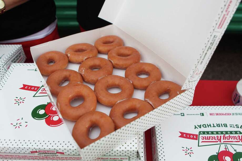 The Krispy Kreme Cruiser is promoting the doughnut maker's 75th birthday tour by handing out doughnuts in Houston today. Oct. 17, 2012. / Johnny Hanson / Houston Chronicle Photo: .