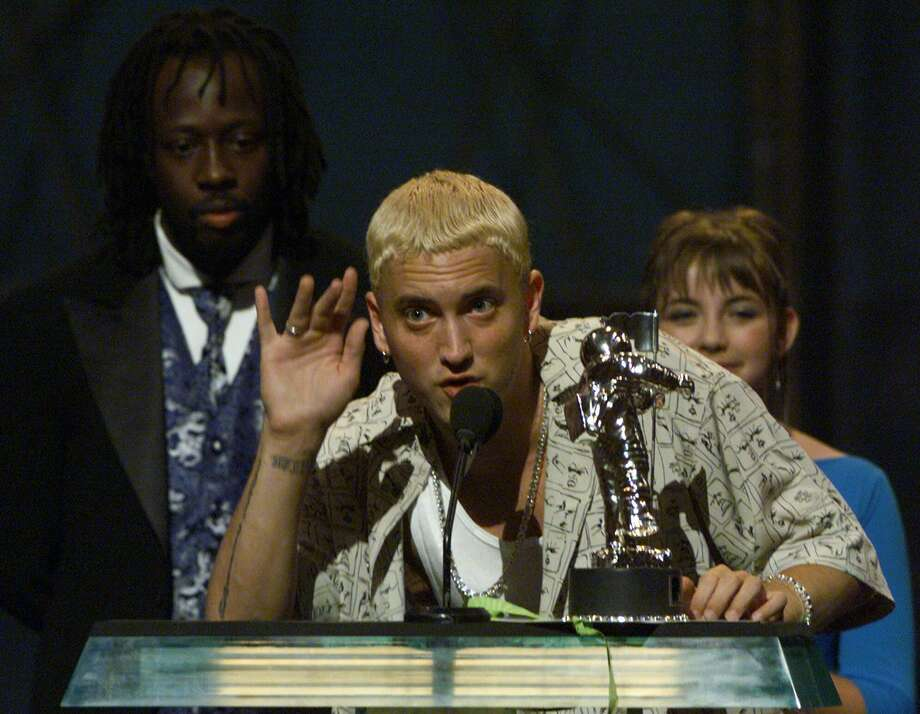"Eminem breaks on to the national scene with the release of ""The Slim Shady LP"" in 1998.Above, he accepts his best new artist in a video award for ""My Name Is,"" during the MTV Video Awards in New York, Thursday, Sept. 9, 1999. Flanking him are presenters Wyclef Jean and Charlotte Church. Photo: RON FREHM, ASSOCIATED PRESS / Associated Press"