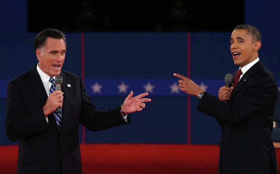 HEMPSTEAD, NY - OCTOBER 16:  Republican presidential candidate Mitt Romney (L) and U.S. President Barack Obama talk to each other during a town hall style debate at Hofstra University October 16, 2012 in Hempstead, New York. During the second of three presidential debates, the candidates fielded questions from audience members on a wide variety of issues.  (Photo by Spencer Platt/Getty Images)   *** BESTPIX *** Photo: Spencer Platt, Getty Images / 2012 Getty Images