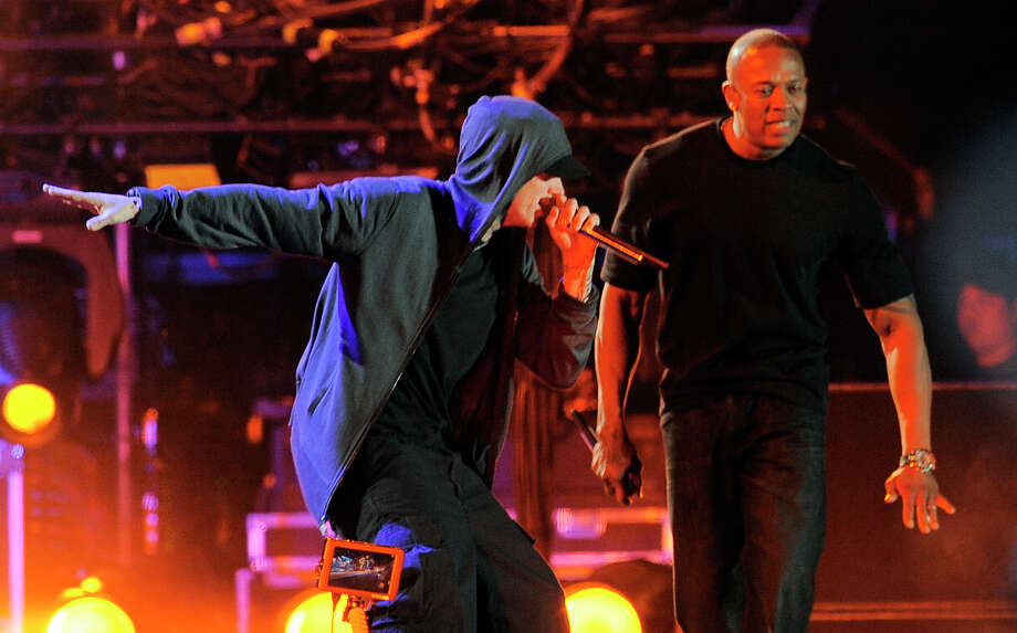 Still going at 40: Eminem, left, performs with Dr. Dre during the headlining performance by Dre and Snoop Dogg on the first weekend of the 2012 Coachella Valley Music and Arts Festival in 2012. Photo: AP