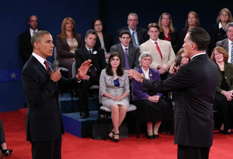 HEMPSTEAD, NY - OCTOBER 16: U.S. President Barack Obama (L) debates Republican presidential candidate Mitt Romney (R) during a town hall style meeting at Hofstra University October 16, 2012 in Hempstead, New York. During the second of three presidential debates, the candidates fielded questions from audience members on a wide variety of issues. (Photo by Win McNamee/Getty Images)   *** BESTPIX *** Photo: Win McNamee, Getty Images / 2012 Getty Images