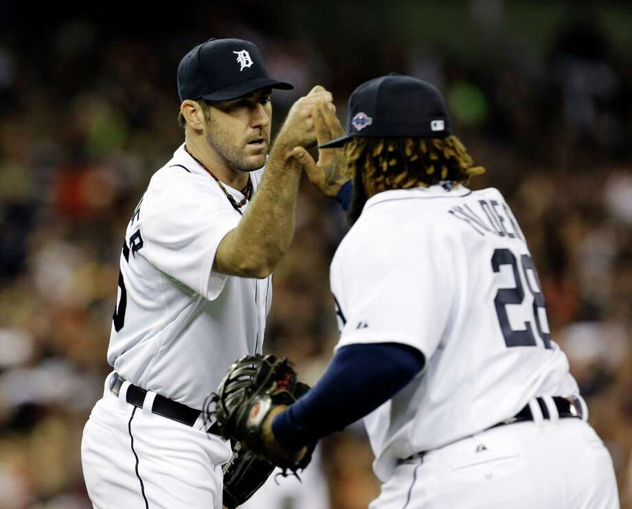 Detroit Tigers' Justin Verlander congratulates first baseman Prince Fielder after New York Yankees' Raul Ibanez grounded out to Fielder in the seventh inning during Game 3 of the American League championship series Tuesday, Oct. 16, 2012, in Detroit. Photo: Paul Sancya, AP / AP