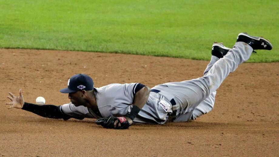 New York Yankees' Eduardo Nunez makes a play on a ball hit by Detroit Tigers' Andy Dirks in the fifth inning during Game 3 of the American League championship series Tuesday, Oct. 16, 2012, in Detroit. Photo: Charlie Riedel, AP / AP