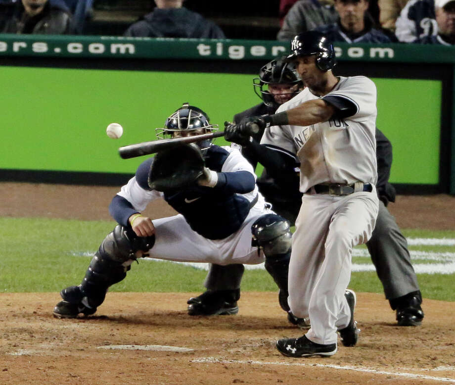 New York Yankees' Eduardo Nunez hits a home run in the ninth inning during Game 3 of the American League championship series against the Detroit Tigers Tuesday, Oct. 16, 2012, in Detroit. Photo: Charlie Riedel, AP / AP