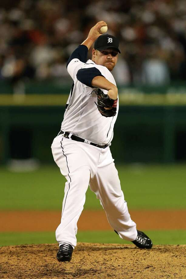 DETROIT, MI - OCTOBER 16:  Phil Coke #40 of the Detroit Tigers throws a pitch against the New York Yankees during game three of the American League Championship Series at Comerica Park on October 16, 2012 in Detroit, Michigan. Photo: Jonathan Daniel, Getty Images / 2012 Getty Images