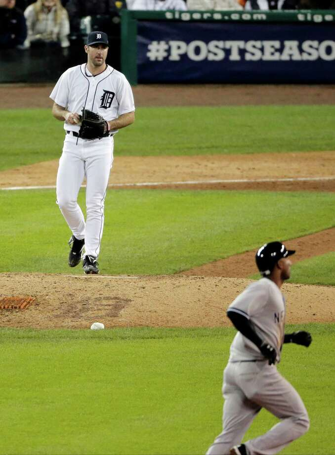 Detroit Tigers' Justin Verlander returns to the mound after New York Yankees' Eduardo Nunez hits a home run in the ninth inning during Game 3 of the American League championship series Tuesday, Oct. 16, 2012, in Detroit. Photo: Charlie Riedel, AP / AP