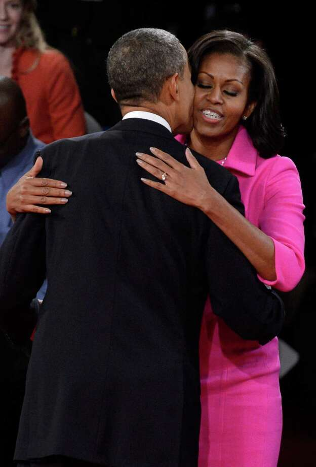 HEMPSTEAD, NY - OCTOBER 16:  U.S. President Barack Obama and first lady Michelle Obama embrace after a town hall style debate at Hofstra University October 16, 2012 in Hempstead, New York. During the second of three presidential debates, the candidates fielded questions from audience members on a wide variety of issues. Photo: Pool, Getty Images / 2012 Getty Images