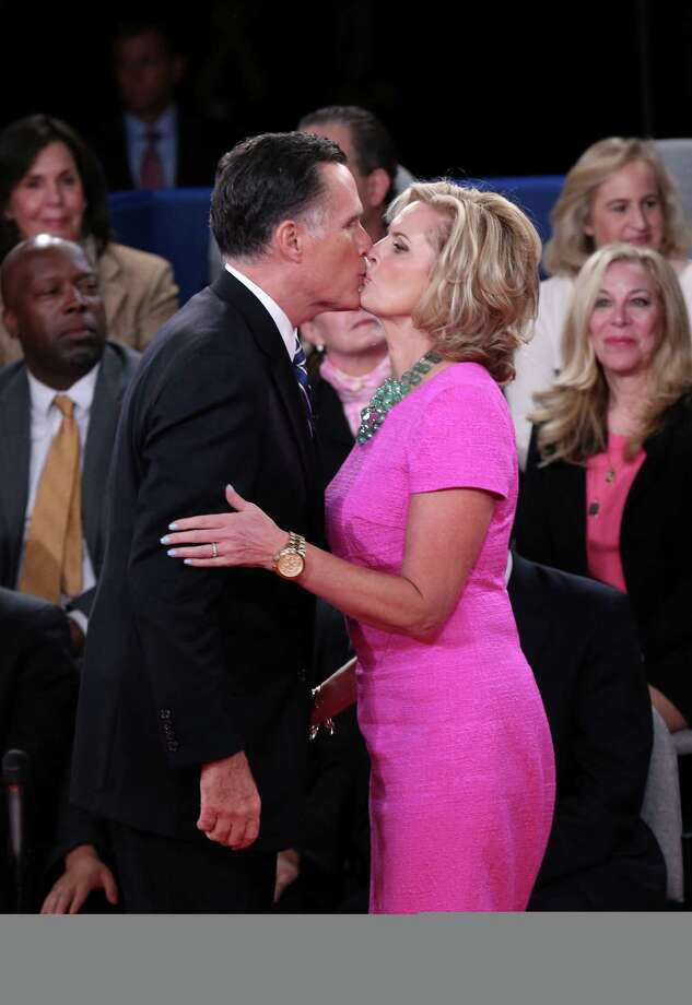 HEMPSTEAD, NY - OCTOBER 16: Republican presidential candidate Mitt Romney kisses wife Ann Romney after a town hall style debate with U.S. President Barack Obama at Hofstra University October 16, 2012 in Hempstead, New York. During the second of three presidential debates, the candidates fielded questions from audience members on a wide variety of issues. Photo: Win McNamee, Getty Images / 2012 Getty Images
