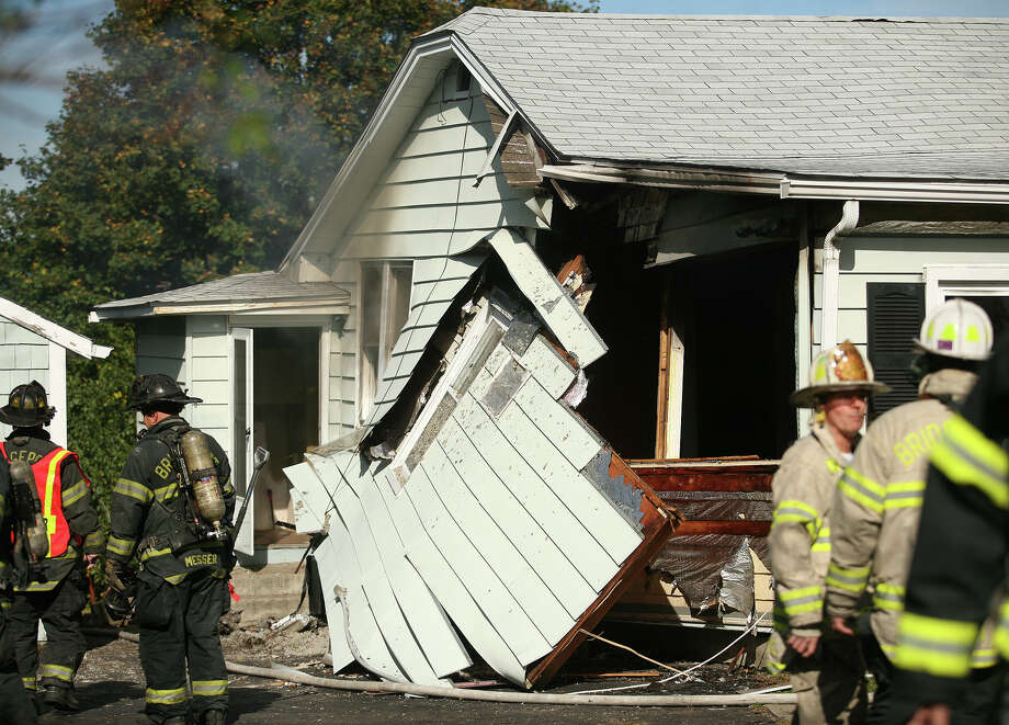Firefighters on the scene of an explosion that blew out an exterior wall from an vacant house at 876 Merritt Street in Bridgeport on Wednesday, October 17, 2012. Photo: Brian A. Pounds / Connecticut Post