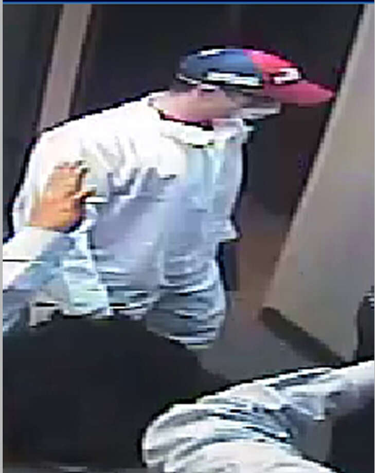 The first suspect in the Aug. 9, 2012, Comerica Bank robbery in the 20000 block of Katy Freeway is described as a white male, 25-29 years old, about 6 feet tall with a slim build. Photo: Crime Stoppers Of Houston