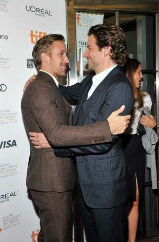 "TORONTO, ON - SEPTEMBER 07:  Actors Ryan Gosling (L) and Bradley Cooper attend ""The Place Beyond The Pines"" premiere during the 2012 Toronto International Film Festival at Princess of Wales Theatre on September 7, 2012 in Toronto, Canada.  (Photo by Sonia Recchia/Getty Images) Photo: Sonia Recchia / 2012 Getty Images"