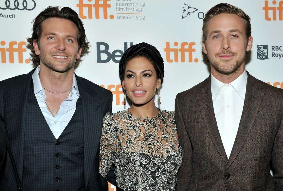 "TORONTO, ON - SEPTEMBER 07: Actors (L-R) Bradley Cooper, Eva Mendes and Ryan Gosling attend ""The Place Beyond The Pines"" premiere during the 2012 Toronto International Film Festival at Princess of Wales Theatre on September 7, 2012 in Toronto, Canada.  (Photo by Sonia Recchia/Getty Images) Photo: Sonia Recchia / 2012 Getty Images"