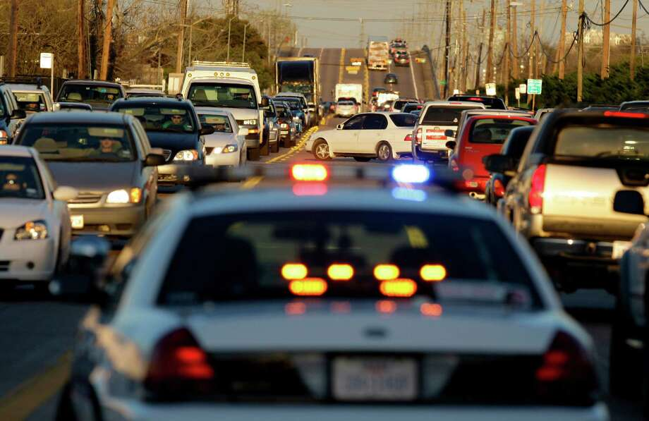 Houston's brutal traffic is sure to attract another Super Bowl right? Good things come to those who wait and who wouldn't want to drive for hours in traffic to Reliant?  Photo: Melissa Phillip, Chronicle / Houston Chronicle
