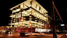 The 1111 Lincoln Road garage, developed by contemporary art collector Robert Wennett, in Miami Beach, Fla., Jan. 11, 2011. Wennett's garage appears to be an entirely new form of architecture for parking structures, resembling the most glamorous, upscale and stylish settings and competing for events with high-end hotel ballrooms, restaurant halls and catering outfits. (Michael McElroy for The New York Times)
