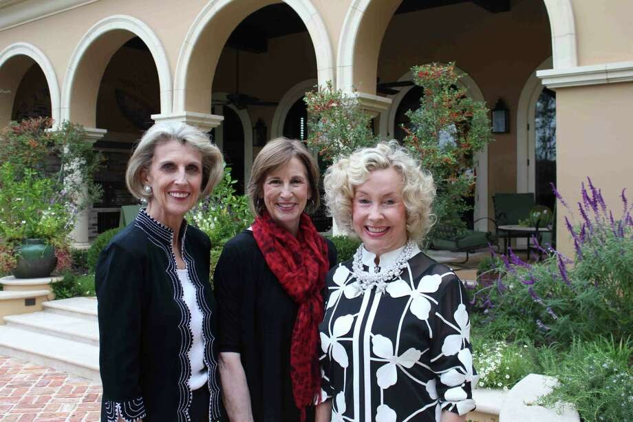 Event chairwoman Beverly Purcell Guerra, from left, hostess Linda Whitacre and Friends of Hospice President Dee Ann Simpson admire the gardens of the Whitacre home at the Friends of Hospice coffee. Photo: Mary Beth Fisk