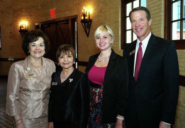 "Outgoing foundation President Arline Patterson (from left) and Texas  A&M San Antonio President Maria Hernandez Ferrier get together with  student Laura de Leon and incoming foundation President Mark Outlaw  during the Texas A&M San Antonio Foundation ""Dream Maker"" luncheon  at the Pearl Stable.