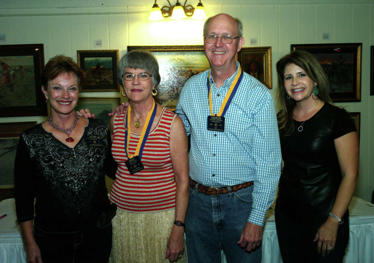 North West Rotary Club President JoAnn Browne (from left), member Grace James, event chairman Charles Johnson and Any Baby Can development director Kay Maynard gather during the event North West San Antonio Rotary Club Art With a Country Heart auction at Pedrotti's North Wind Ranch.