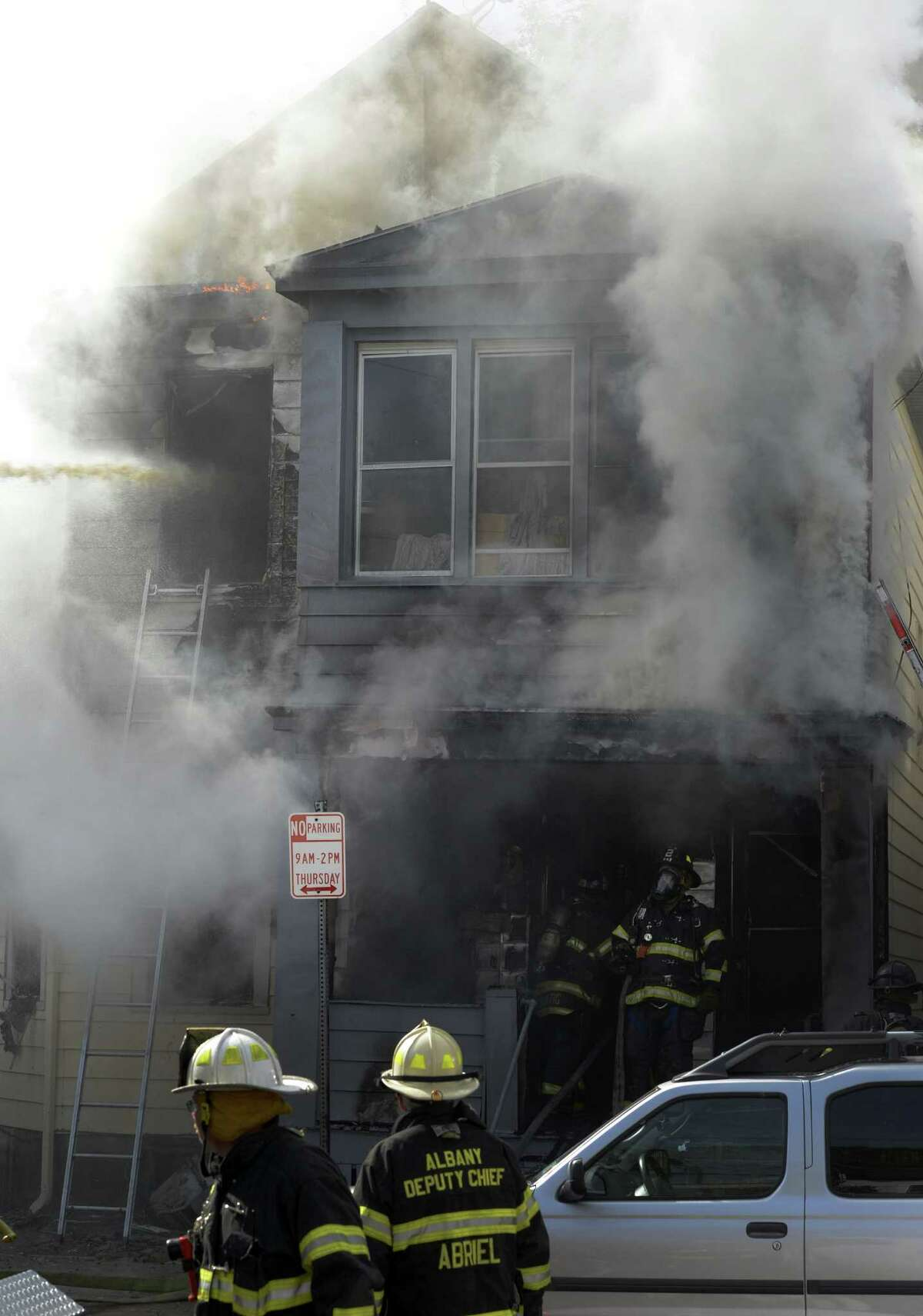 Albany Fire Department personnel fight a fire at 20 Benson St. in Albany, N.Y. Oct 17, 2012. A child rescued from the building was taken to a burn unit in Boston by helicopter, according to Chief Robert Forezzi of the Albany Fire Department. She later died. (Skip Dickstein/Times Union)